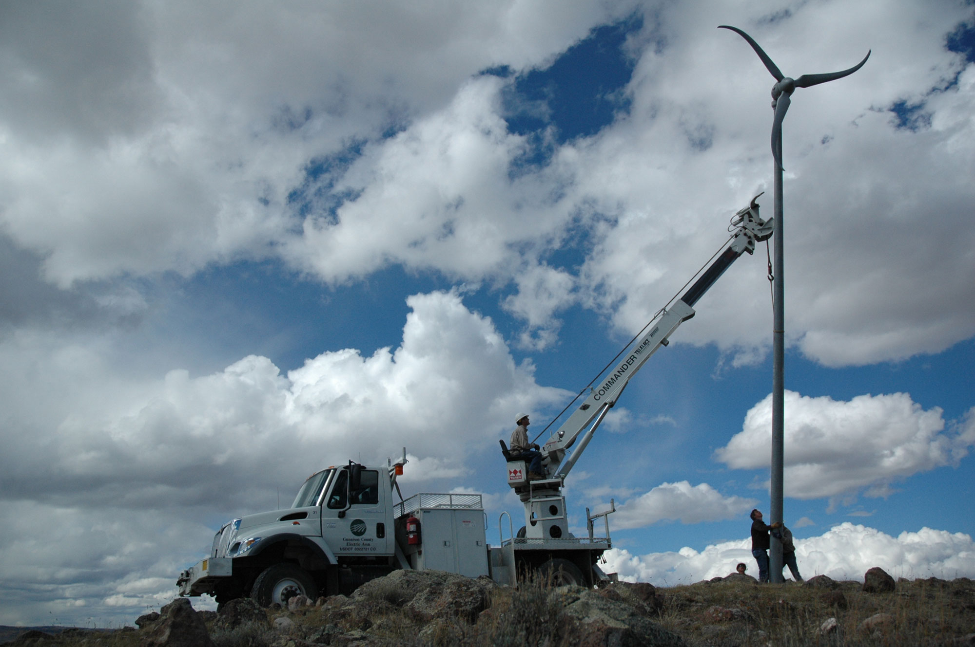 lineworkers putting up wind turbine