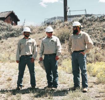 three lineman standing outside