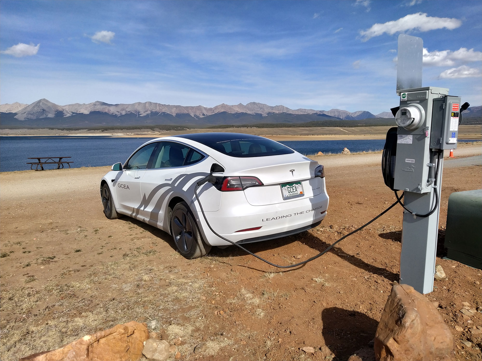 electric vehicle charging at station